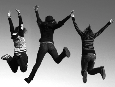 Black and White picture of three girls jumping in the air