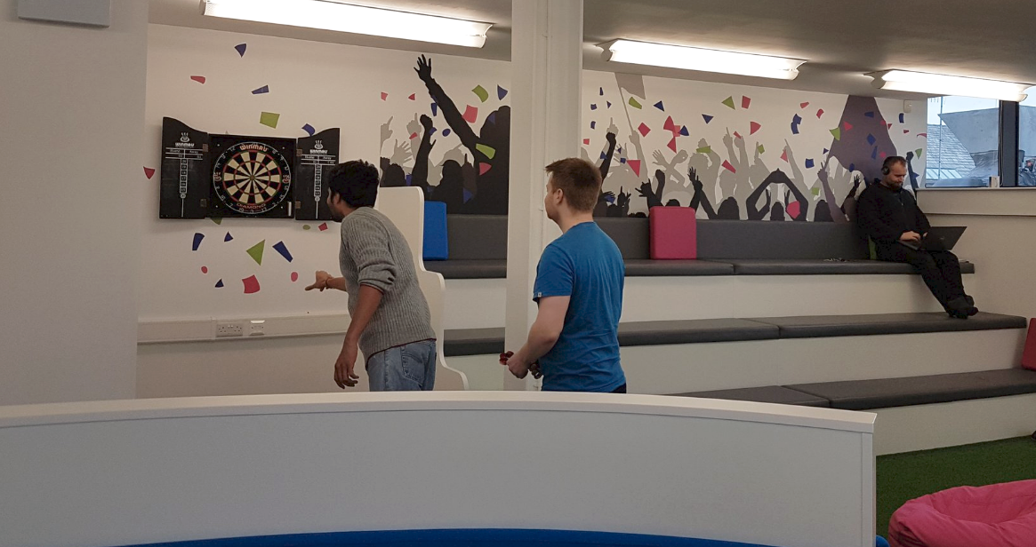 Team playing darts.png