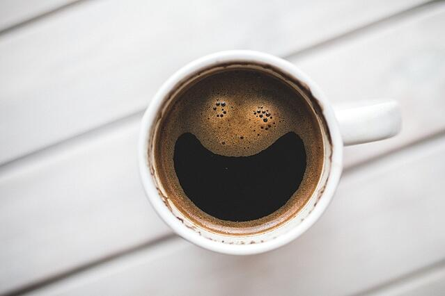 Coffee cup with smile in froth