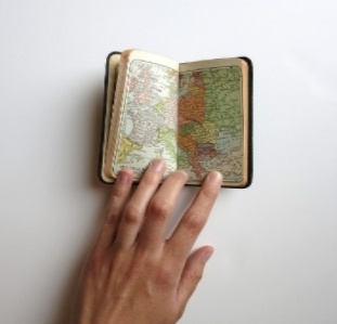 Person looking at map in journal