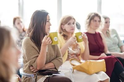 ladies attending event drinking tea