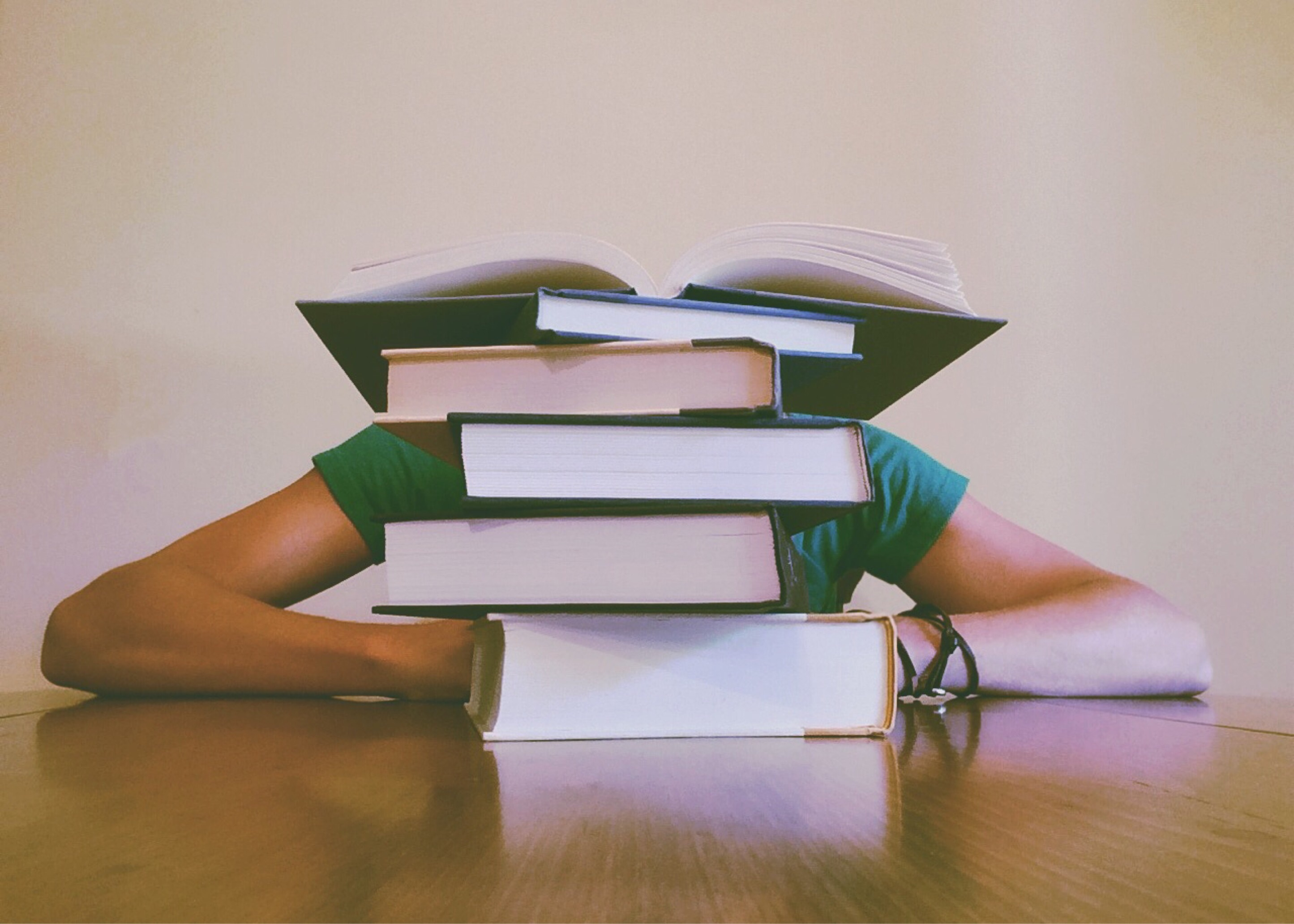 Learner with books, not using training management software