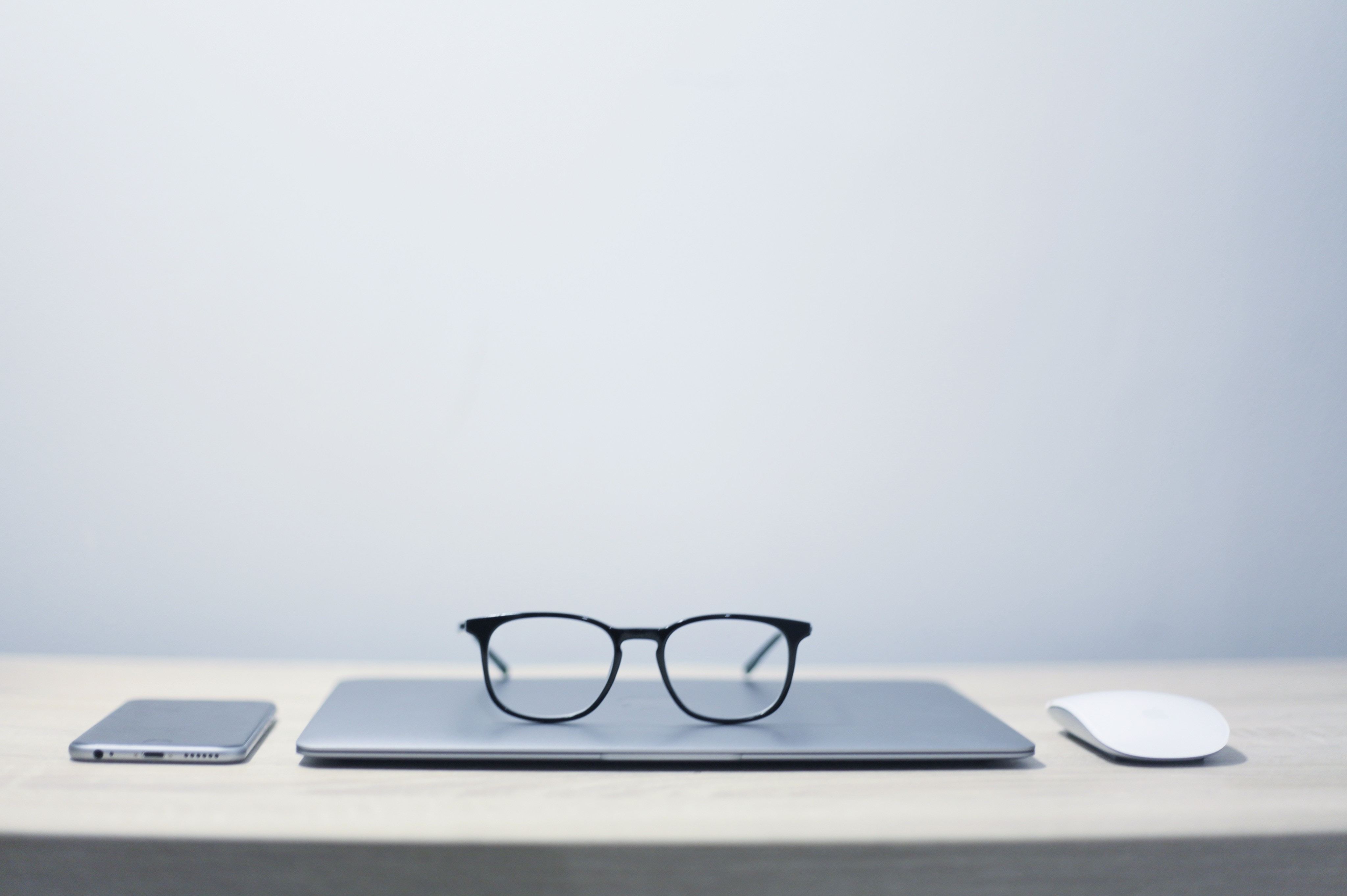 Trainer's glasses resting on training management software system