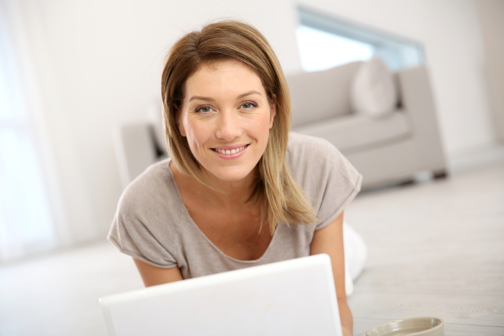 Woman websurfing on the net with laptop