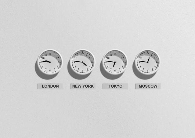 Business time clocks on wall