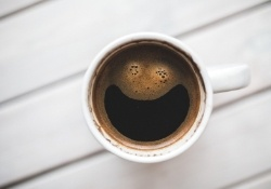 Coffee cup from above with smiley face