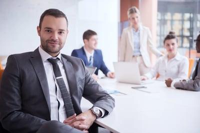 leaders sat in a room talking business