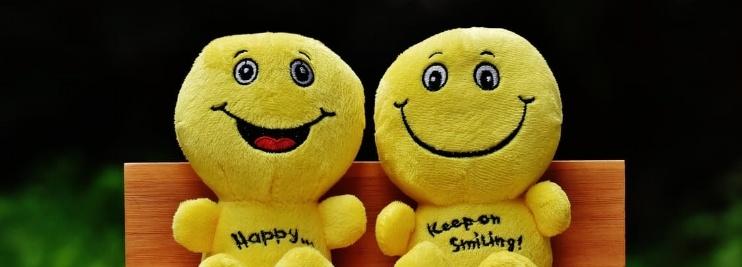 Yellow smiley stuffed toys