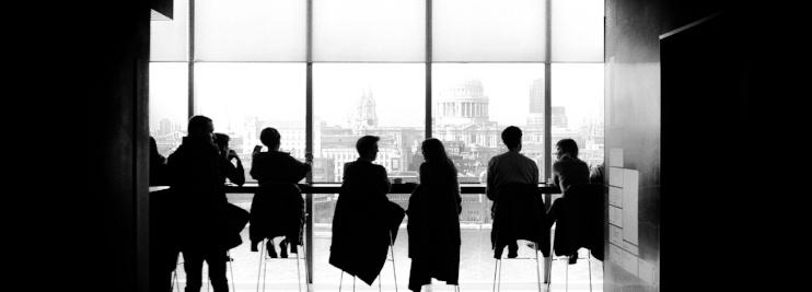 Group of people sat in window